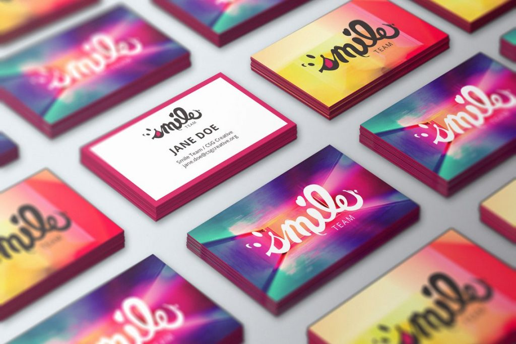 Two varieties of branded business cards for Smile Team's printed core identity..