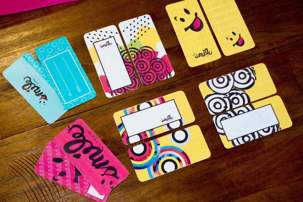 Case study: Smile Team. Gift tag varieties spread out on a table.