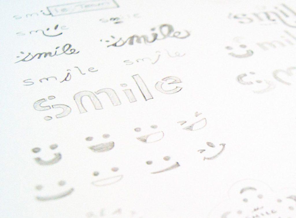Case study: Smile Team. Initial logo design sketches.