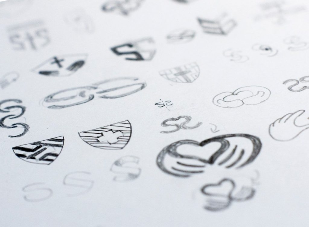 Case study: SPC Safety and Security. Initial sketches for the logo design.