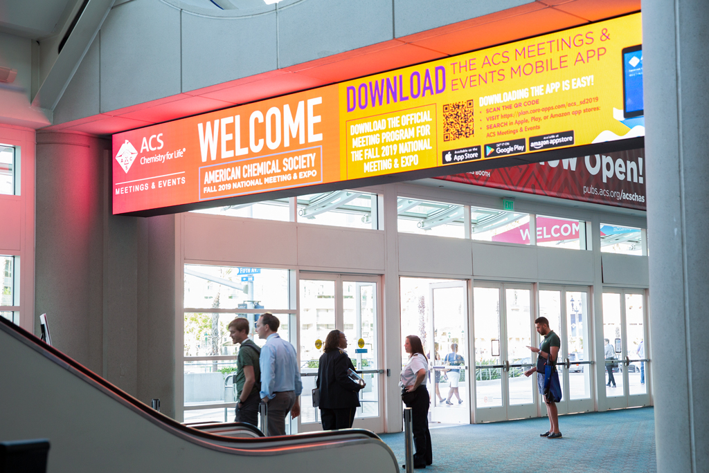 Onsite photo of the Welcome and Mobile App signs.