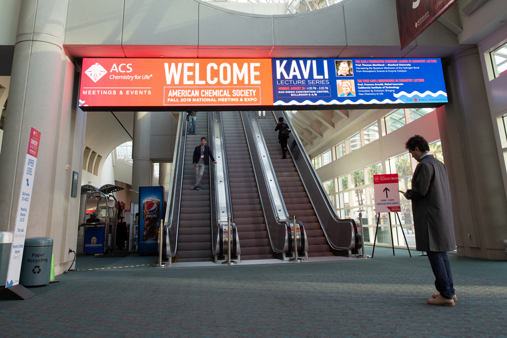 Front-view onsite photo of the Welcome and Kavli Lecture Series digital signage.