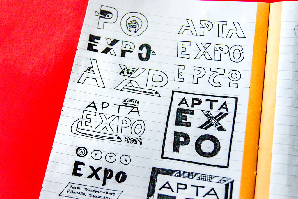 Ink sketches for the APTA Expo logo design experiment with breaking up the letter forms.