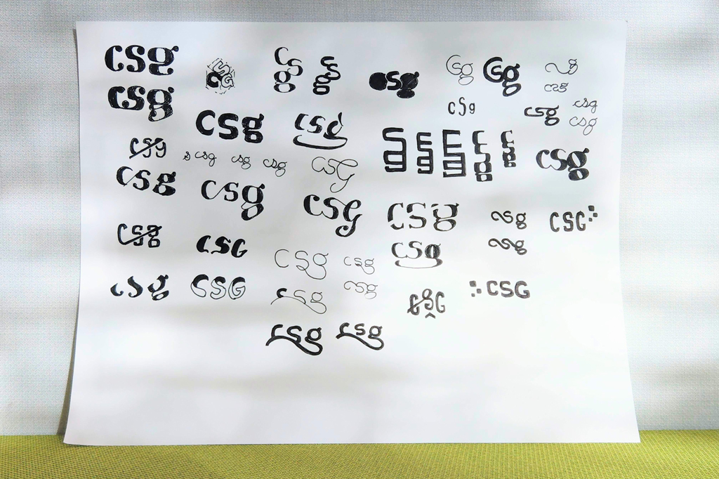 Inked logotype sketches for the new CSG Creative logo.