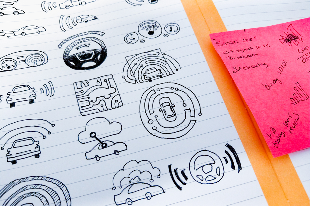 Early steps in my logo creation process involve jotting down key themes and sketching relevant iconography, like those shown on this Post-It note beside sketches for the NAB Show Las Vegas' In-Vehicle Experience (IVE) pavilion.